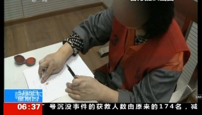 Принудительные признания журналистки показало телевидение Китая