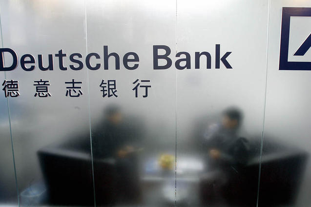 Deutsche Bank был уличён в приёме на работу в Китае «правильных» сотрудников. Фото: TEH ТЕСНО KOON/AFP/Getty Images