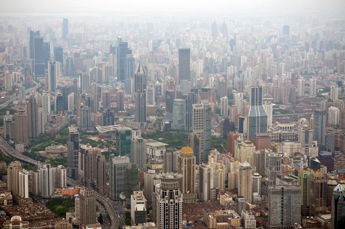 Шанхайский район Пудун 2 августа 2013 года. Взрыв пузыря на рынке недвижимости в Китае — это лишь вопрос времени. Фото: Peter Parks/AFP/Getty Images