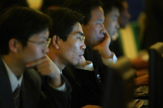 Коммунистическая партия Китая жёстко контролирует Интернет, используя пять основных методов. Фото: Frederic J. Brown/AFP/Getty Images