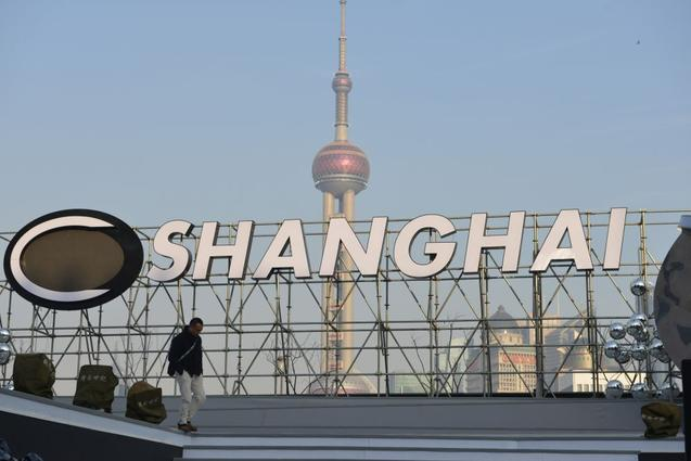 Шанхайская фондовая биржа в 2013 году останавливала торги акциями Everbright Securities. Фото: PETER PARKS/AFP/Getty Images