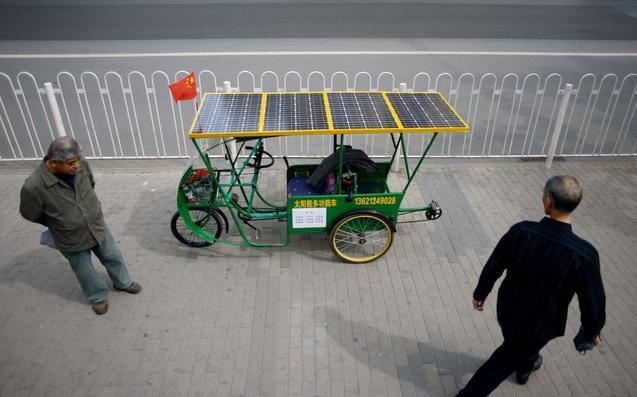 Велосипед на солнечных батареях, Пекин, 14 мая 2014 года. Фото: WANG ZHAO/AFP/Getty Images