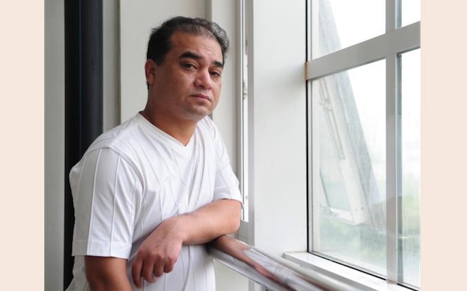 Ильхам Тохти, профессор экономики и основатель популярного уйгурского веб-сайта, был арестован в конце 2013 года за пропаганду свободных взглядов. В Синьцзяне сохраняются жёсткие ограничения по использованию Интернета. Фото: Frederic J.Brown/AFP/Getty Images