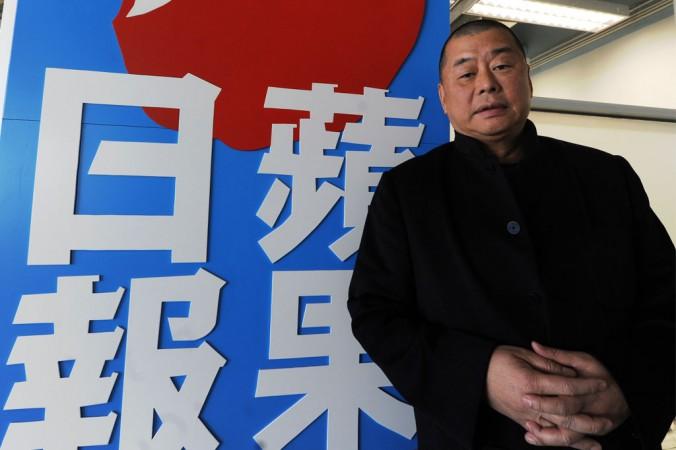 Джимми Лай стоит около офиса своей компании в Гонконге 7 февраля 2011 года. Фото: Mike Clarke/AFP/Getty Images