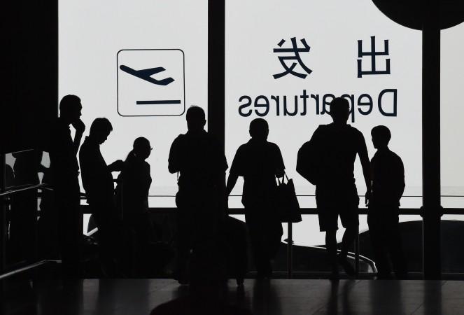 Более ста рейсов между Пекином и Шанхаем были отменены во второй половине дня 14 июля якобы из-за военных учений, согласно китайским государственным СМИ. Фото: GREG BAKER/AFP/Getty Images