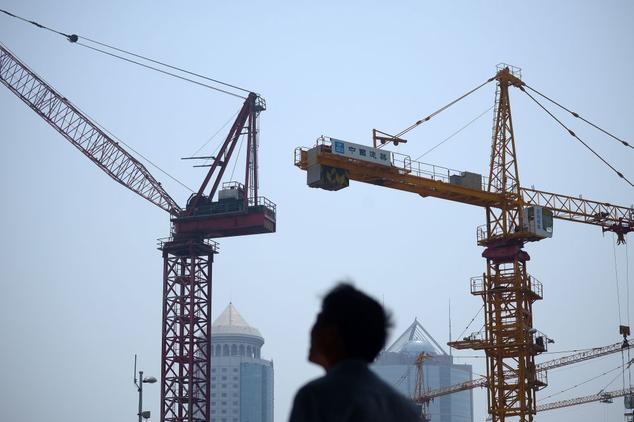 15% китайского ВВП обеспечивает рынок недвижимости. Его крах обрушит всю экономику Китая. Фото: WANG ZHAO/AFP/Getty Images