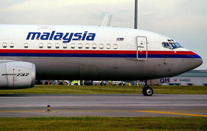 """Малазийский """"Боинг"""". Фото: IMIN LAI/AFP/Getty Images"""
