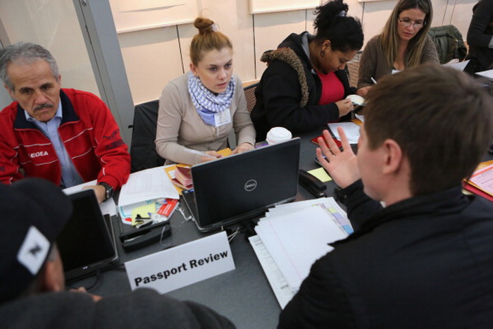 Мигранты в России будут сдавать экзамены. Фото: John Moore/Getty Images