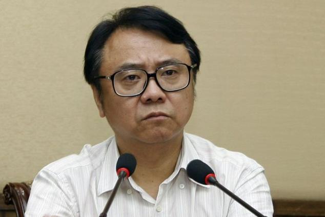 Ван Цзуннань на встрече в Шанхае 11 августа 2012 года. Сейчас он арестован за коррупцию и хищение средств государственной компании. Фото: STR/AFP/Getty Images