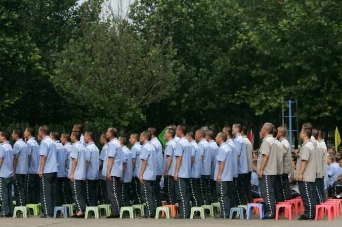 Заключённые в тюрьме «Тяньхэ», 8 августа 2007 года, Пекин, Китай. Недавняя отмена двух смертных приговоров в провинции Фуцзянь не означает какое-либо изменение в судебной системе Китая. Фото: China Photos/Getty Images
