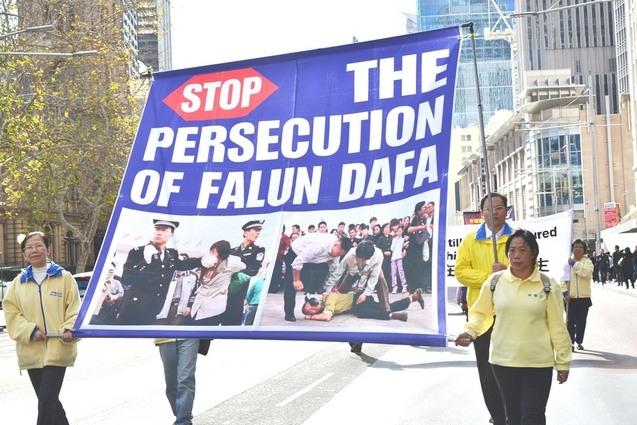 Сторонники Фалуньгун выражают протест против преследования своих единомышленников в Китае. Сидней, Австралия. 2014 год. Фото: minghui.org