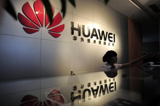 Администратор в офисе телекоммуникационной фирмы Huawei Technologies в Ухане, Китай, 8 октября 2012 года. Huawei обвинили в подделке правительственных документов и краже электронной почты в Южном Судане. Фото: STR/AFP/Getty Images
