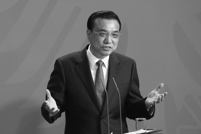 Китайский премьер Ли Кэцян на пресс-конференции в Германии во время немецко-китайских правительственных консультаций в Берлине 10 октября 2014 года. Премьер Ли подтвердил, что китайское руководство поддерживает политику «одна страна — две системы» в Гонконге. Фото: Adam Berry/Getty Images