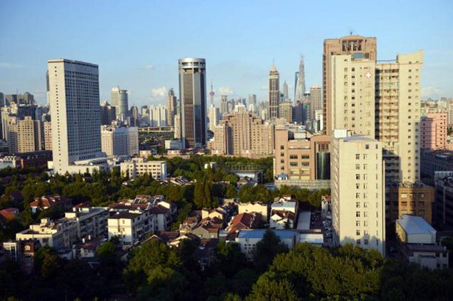 Виды на офисные и жилые здания в Шанхае. Фото: Peter Parks/AFP/Getty Images