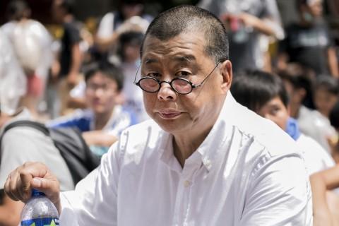 Гонконгский медиамагнат и сторонник демократии Джимми Лай на митинге возле здания правительства в Гонконге 28 сентября 2014 года. Фото: Alex Ogle/AFP/Getty Images