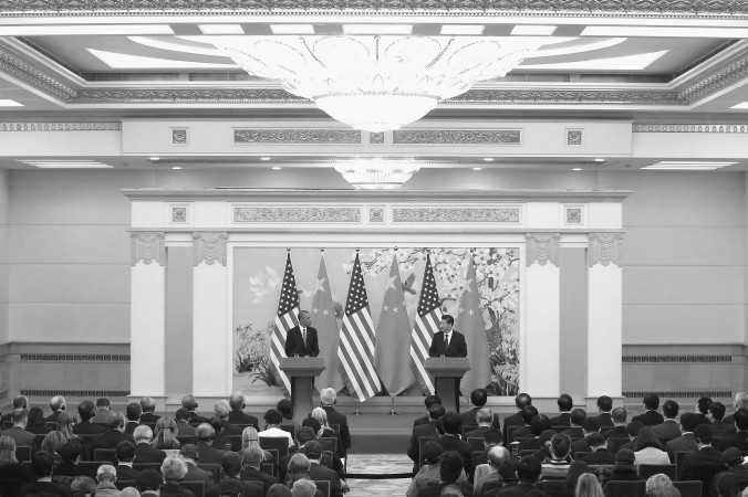 Президент США Барак Обама (слева) и китайский лидер Си Цзиньпин на пресс-конференции в Большом зале народных собраний 12 ноября 2014 года, Пекин, Китай.