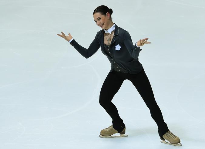 Российская фигуристка Алёна Леонова в короткой программе на турнире NHK Trophy в Осако, Япония, 28 ноября, 2014 год.  Фото: TOSHIFUMI KITAMURA/AFP/Getty Images