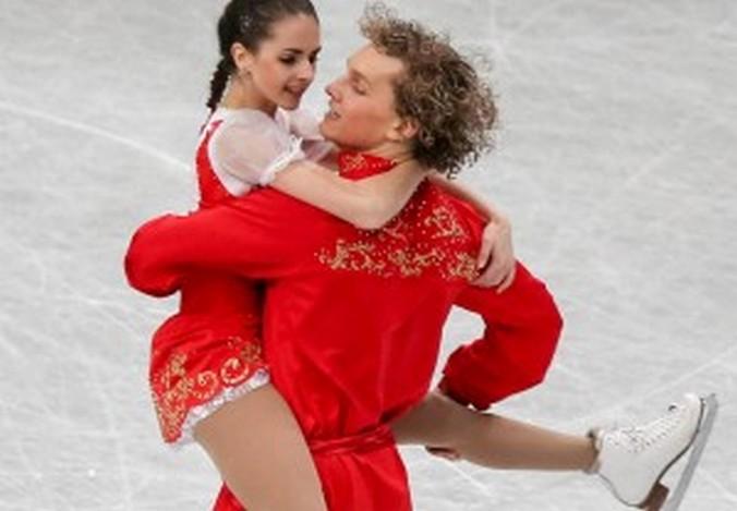 Наталья Забияко и Александр Забоев выступают на Чемпионате мира по фигурному катанию в японском городе Сайтама 26 марта 2014 года. Фото: Chris McGrath/Getty Images
