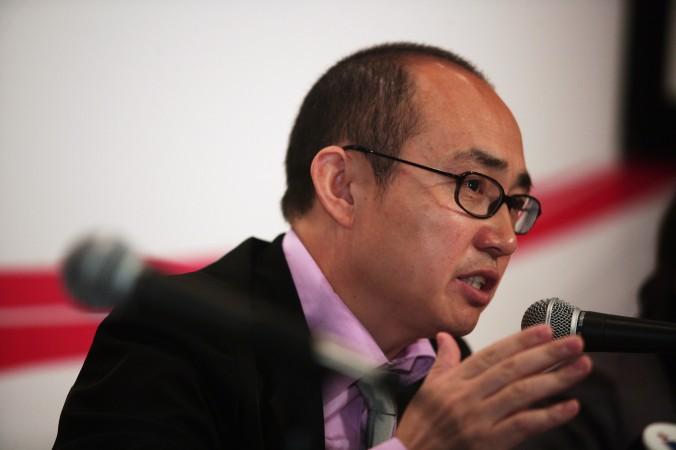 Пань Шии, глава девелоперской компании SOHO в Китае, рассказывает о финансовых результатах 13 марта 2009 года в Гонконге. На недавней конференции в Пекине он призвал к прекращению блокады Интернета. Фото: Lo Ka Fai/China Photos/Getty Images