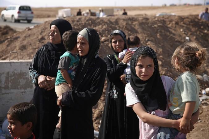 Беженцы Сирии у контрольно-пропускного пункта в Ираке, 14 июня, 2014 год. Фото: Dan Kitwood/Getty Images