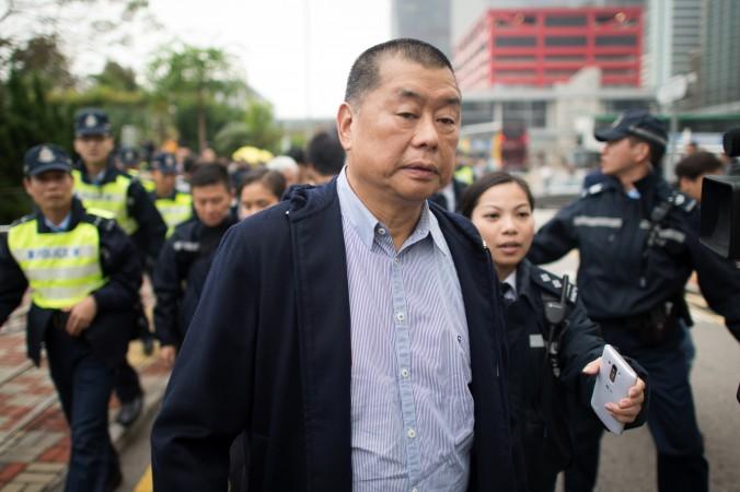 Гонконгский медиа-магнат и сторонник демократии Джимми Лай, основатель Next Media, выходит из полицейского участка в Гонконге 3 декабря 2014 года. Фото: Johannes Eisele/AFP/Getty Images