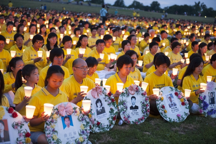Сторонники Фалуньгун проводят акцию памяти своих единомышленников, погибших в Китае в результате репрессий со стороны компартии. Вашингтон. Фото: The Epoch Times