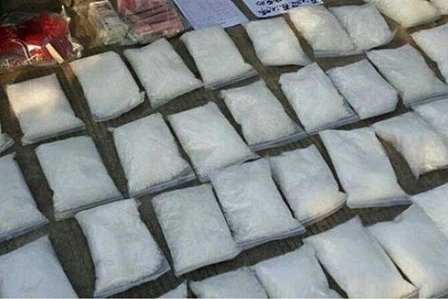 Конфискованный у незаконных производителей метамфитамин. Китай. Фото с epochtimes.com