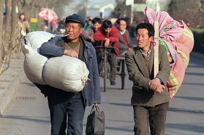 Китайские рабочие-мигранты. Фото: ROBYN BECK/AFP/Getty Images