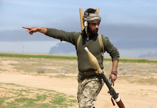 Иракский боец-шиит из вооружённой проправительственной группировки, воюющей против ИГИЛ, 8 марта 2015 г. Фото: Ahmad Al-Rubaye/AFP/Getty Images