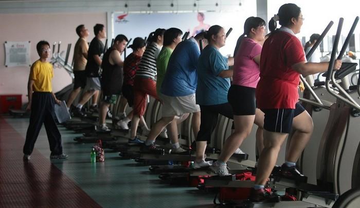 В Китае становится всё больше людей с избыточным весом. Фото: Photo by China Photos/Getty Images