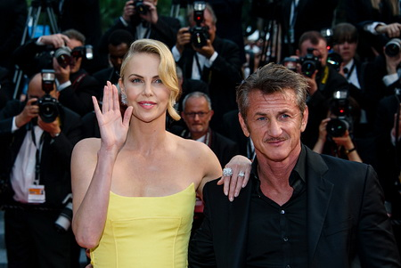 "CANNES, FRANCE - MAY 14:  Actors Sean Penn and Charlize Theron attend the premiere of ""Mad Max: Fury Road"" during the 68th annual Cannes Film Festival on May 14, 2015 in Cannes, France.  (Photo by Clemens Bilan/Getty Images)"