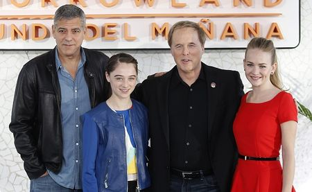 (L to R) US actor George Clooney, British Actress Raffey Cassidy, US film director Brad Brid and US Actress Britt Robenson pose during a press conference presenting their latest film 'Tomorrowland ' at the City of the Arts and Sciences in Valencia May 19,2015.  AFP PHOTO / JOSE JORDAN        (Photo credit should read JOSE JORDAN/AFP/Getty Images)