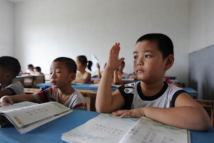 В Китае коррупция начинается со школьной скамьи. Фото: Getty Images