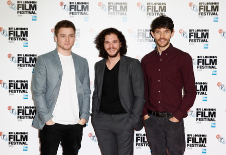 "LONDON, ENGLAND - OCTOBER 14:  Actors Taron Egertonm Kit Harington and Colin Morgan attend the photocall for ""Testament Of Youth"" during the 58th BFI London Film Festival at The Mayfair Hotel on October 14, 2014 in London, England.  (Photo by Tim P. Whitby/Getty Images for BFI)"