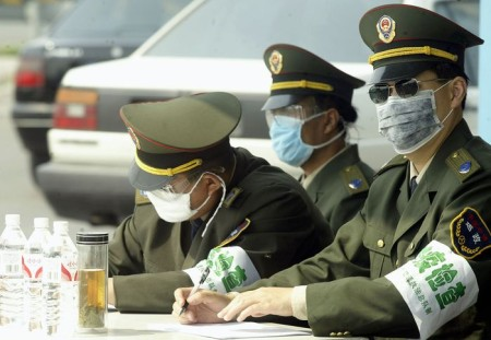 Health Department officers check vehicles at a check point on the outskirts of Beijing, 30 May 2003.  Beijing, the worst affected city in the world from the SARS outbreak, has seen record lows from the disease in the last week with only three cases reported on May 29.  AFP PHOTO/Peter PARKS        (Photo credit should read PETER PARKS/AFP/GettyImages)