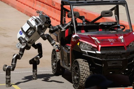POMONA, CA - JUNE 05:  The Jet Propulsion Labs' Team RoboSimian 275-pound robot climbs out of a Polaris vehicle after driving through obsticles during the Defense Advanced Research Projects Agency (DARPA) Robotics Challenge at the Fairplex June 5, 2015 in Pomona, California. The . Organized by DARPA, the Pentagon's science research group, 24 teams from aorund the world are competing for $3.5 million in prize money that will be awarded to the robots that best respond to natural and man-made disasters.  (Photo by Chip Somodevilla/Getty Images)