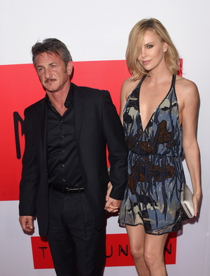"""LOS ANGELES, CA - MARCH 12:  Actors Sean Penn and Charlize Theron attend the premiere of Open Road Films' """"The Gunman"""" at Regal Cinemas L.A. Live on March 12, 2015 in Los Angeles, California.  (Photo by Jason Merritt/Getty Images)"""