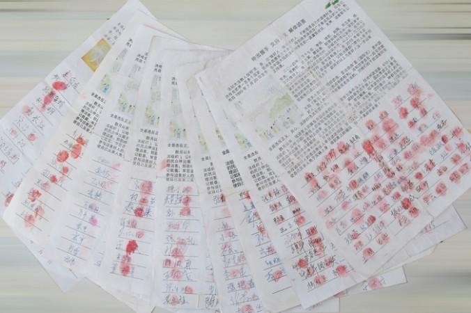 Часть подписей под петицией в защиту 9 арестованных в провинции Хэбэй сторонников Фалуньгун. Фото с minghui.org