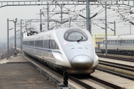 The high speed train that runs on the new 2,298-kilometre (1,425-mile) line between Beijing and Guangzhou runs into Xuchang East Station in Xuchang, central China's Henan province on December 26, 2012. China started service on December 26 on the world's longest high-speed rail route, the latest milestone in the country's rapid and -- sometimes troubled -- super fast rail network. The opening of this new line means passengers will be whisked from the capital to the southern commercial hub in just eight hours, compared with the 22 hours previously required. CHINA OUT AFP PHOTO (Photo credit should read STR/AFP/Getty Images)