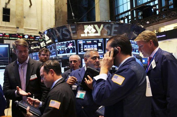 Нью-Йоркская фондовая биржа (NYSE). 8 июля из-за помех на бирже торги были прекращена на четыре часа. Организация «Анонимус» считает, что за этим стояли китайские власти. Фото: Spencer Platt/Getty Images