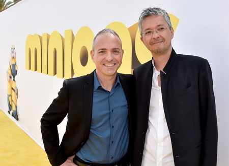 "LOS ANGELES, CA - JUNE 27:  Directors Kyle Balda (L) and Pierre Coffin arrive at the premiere of Universal Pictures and Illumination Entertainment's ""Minions"" at the Shrine Auditorium on June 27, 2015 in Los Angeles, California.  (Photo by Kevin Winter/Getty Images)"