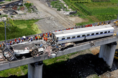 "This aerial photo taken on July 24, 2011 shows rescue operations continuing on the wreckages of two high-speed trains that collided the night before in the town of Shuangyu, on the outskirts of Wenzhou in the eastern Chinese province of Zhejiang. China has ordered an ""urgent"" overhaul of rail safety, state media said on July 24, after the train crash killed 35 people and injured over 200 in the worst accident to ever hit the country's high-speed rail network.  CHINA OUT AFP PHOTO (Photo credit should read STR/AFP/Getty Images)"