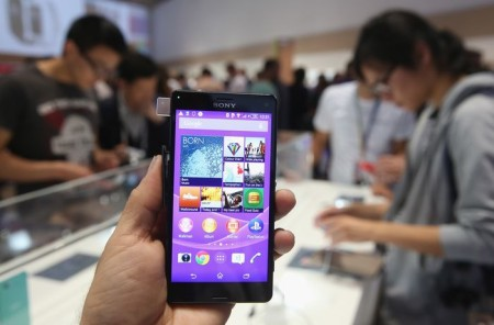 BERLIN, GERMANY - SEPTEMBER 05:  The photographer holds up a Sony Xperia Z3 smartphone at the Sony stand at the 2014 IFA home electronics and appliances trade fair on September 5, 2014 in Berlin, Germany. IFA is the world's biggest fair of its kind and is open to the public through September 10.  (Photo by Sean Gallup/Getty Images)