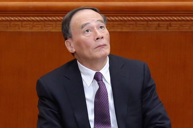 Секретарь центральной комиссии дисциплинарной инспекции Ван Цишань на закрытии сессии политико-консультативного совета 13 марта 2015 года в Пекине. Фото: Feng Li/Getty Images