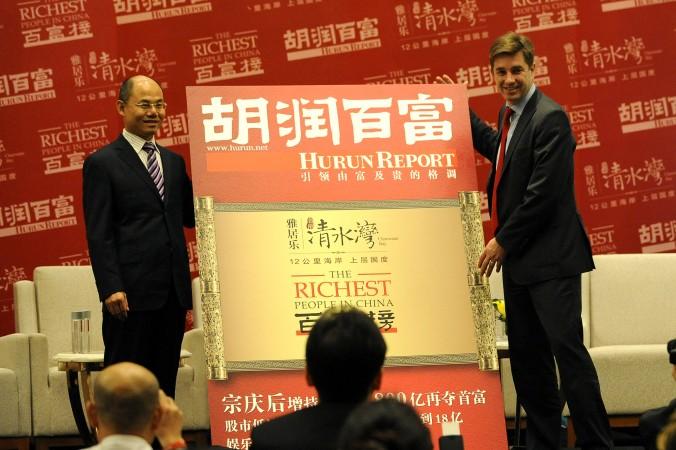 Руперт Хугверф (справа) объявляет самых богатых китайцев, Пекин, 19 октября 2012 года. Фото: Wang Zhao/AFP/Getty Images