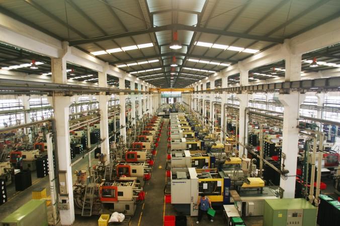 Фабрика по производству пластмассовых игрушек в Дунгуане, провинция Гуандун, 4 сентября 2007 г. Фото: Feng Li/Getty Images