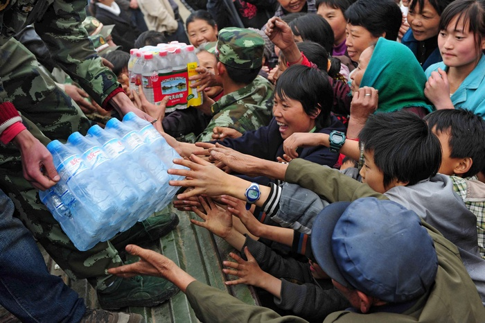 Chinese villagers gather to collect bott