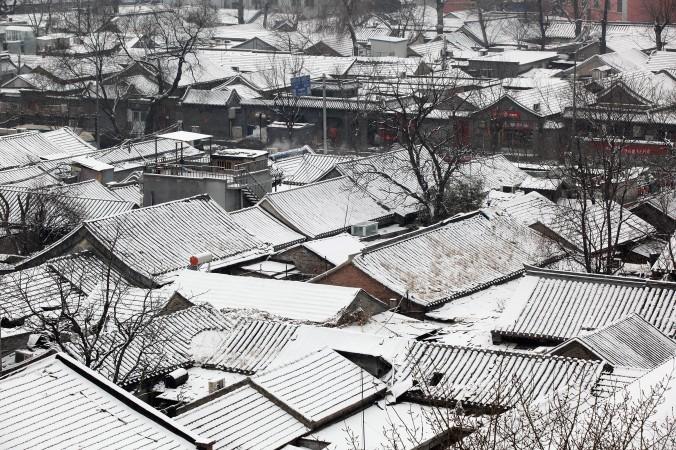Покрытый снегом хутун в Пекине 10 февраля 2011 г. Фото: Feng Li/Getty Images