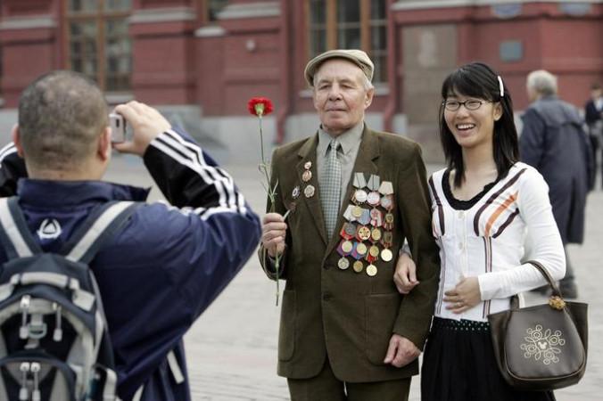 Китайские туристы в Москве. Фото: MAXIM MARMUR/AFP/Getty Images