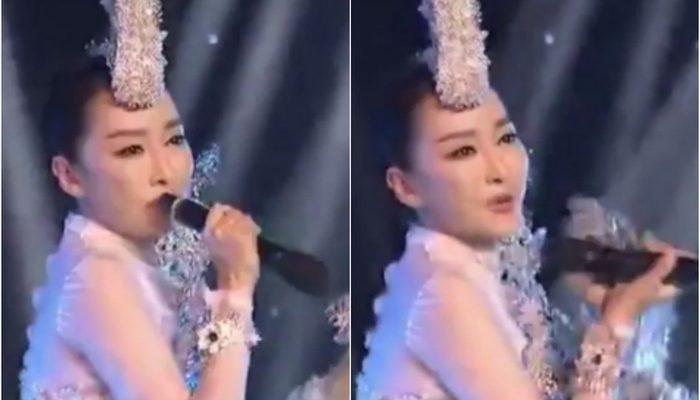 Известная китайская певица выступила с перевёрнутым задом наперёд микрофоном